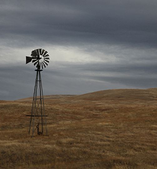 Windmill against a stormy sky